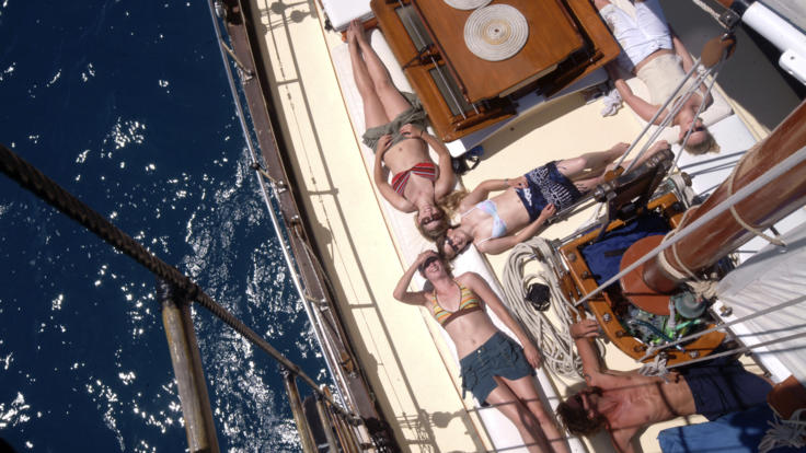 Relax in the sun whilst sailing around the Whitsunday Islands