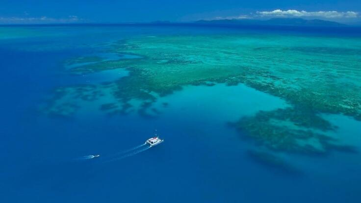 Yacht Charters Cairns - Aerial View of Charter Yacht on the Great Barrier Reef off Cairns