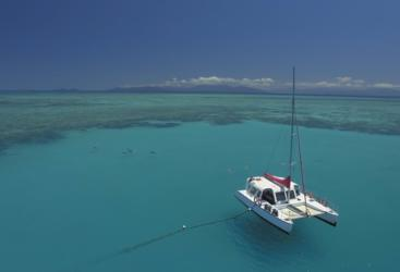 Barrier Reef Australia: Aerial view of catamaran at anchor off Cairns