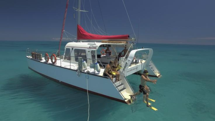 Barrier Reef Australia: Enjoy access into the water from the stern of the catamaran
