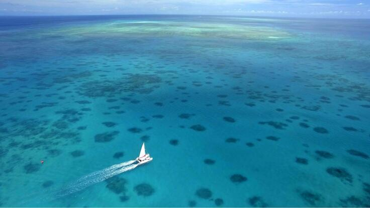 Charter Yachts Cairns - Aerial View Of Charter Yacht on the Great Barrier Reef