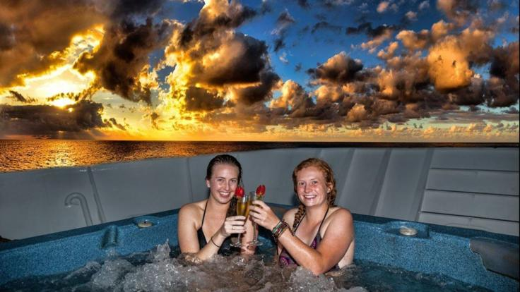 Relax in a hot tub spa under the stars on the Great Barrier Reef