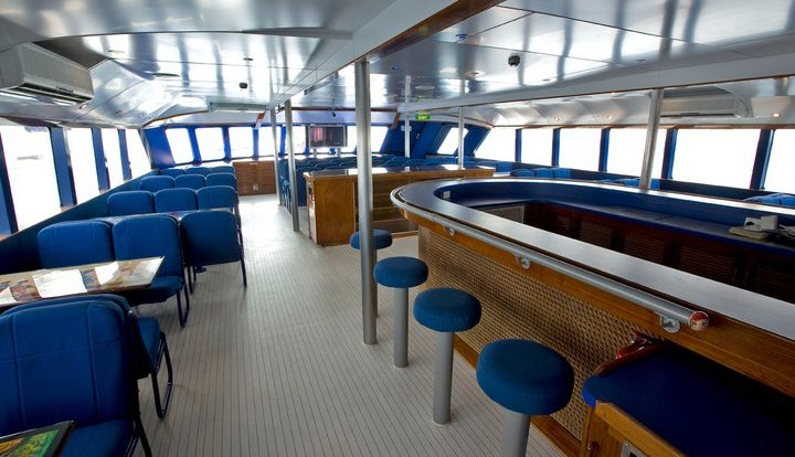 Comfortable and spacious boat interior for relaxing on trip to the Great Barrier Reef