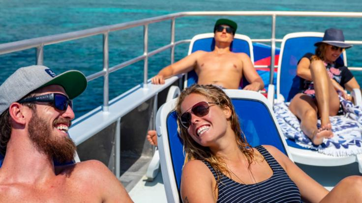 Relax in the sunshine on the upper deck of our Great Barrier Reef tour boat