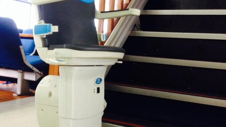 Stairlift on board the vessel for ease of access for disabled guests on Cairns tour.