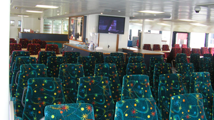Indoor seating on your private charter boat, Perfect for large groups.