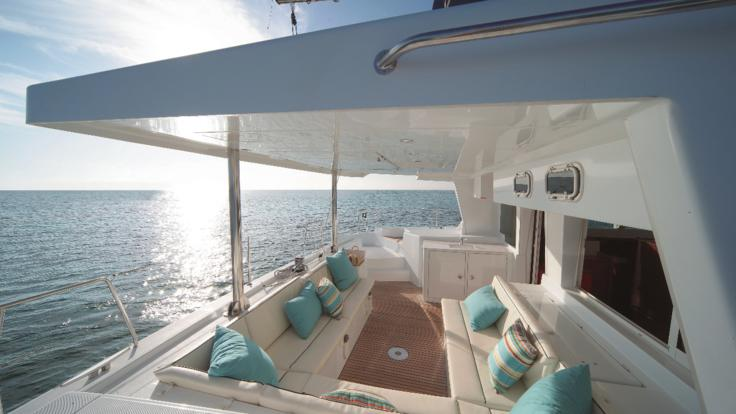 Experience an open water sunset whilst relaxing on this comfortable luxury sunset sail private charter