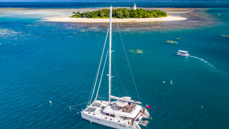 Aerial view of private charter yacht in Port Douglas on the Great Barrier Reef Australia