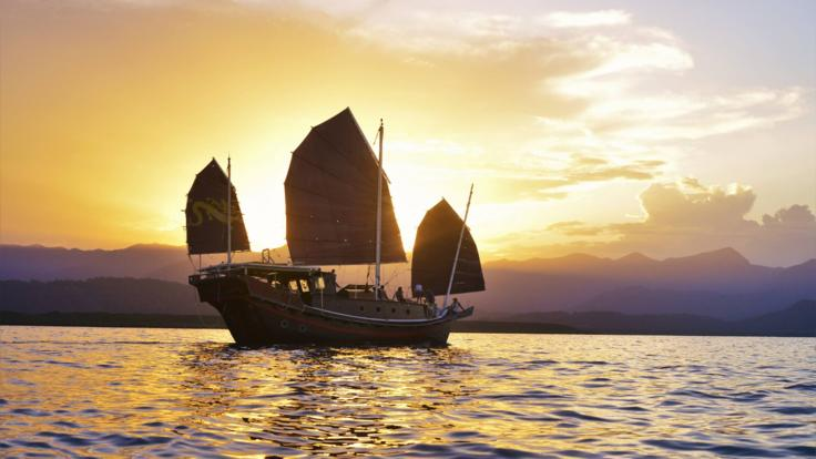 Sail into the sunset aboard your private Chinese Junk vessel.