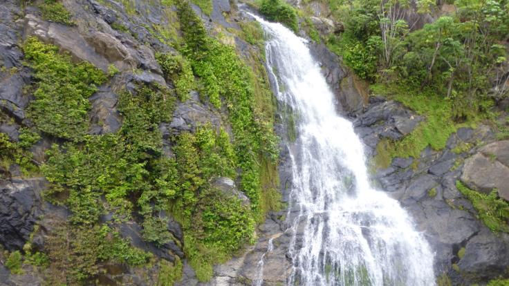 See waterfalls on the mountains from the Kuranda Train