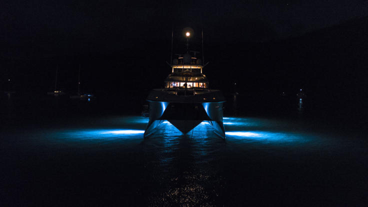 Superyachts Great Barrier Reef - Night view of Superyacht lit up looking at the bow - Great Barrier Reef - Australia