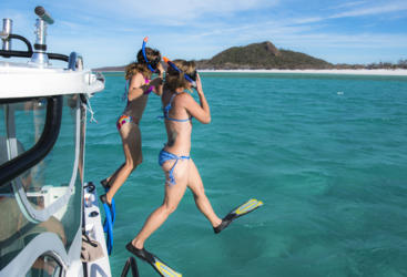 Snorkel the crystal clear waters of the Great Barrier Reef on your private yacht charter - Port Douglas