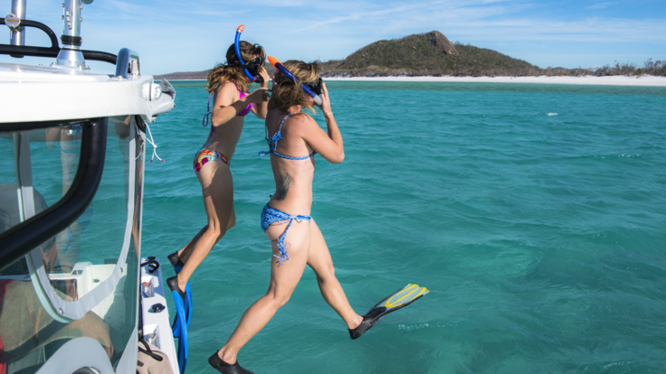 Snorkel the crystal clear waters of the Great Barrier Reef on your private boat charter