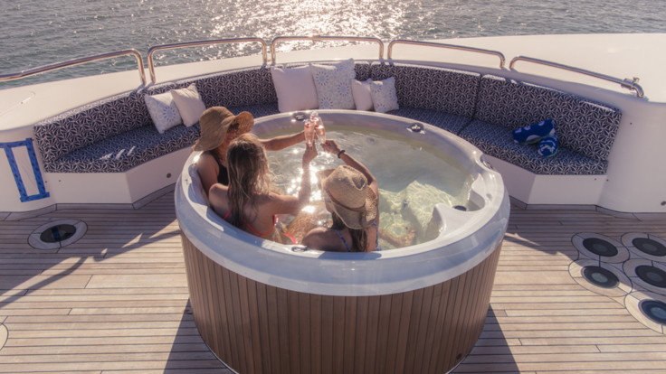 Superyachts Cairns - Relax in the jucuzzi while sipping champagne and enjoying the glorious ocean views on super yacht Great Barrier Reef