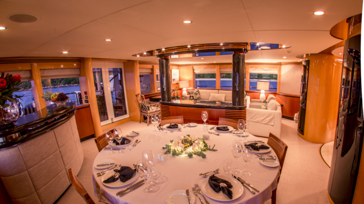 Spacious formal dining room on your luxury super yacht charter boat - Cairns