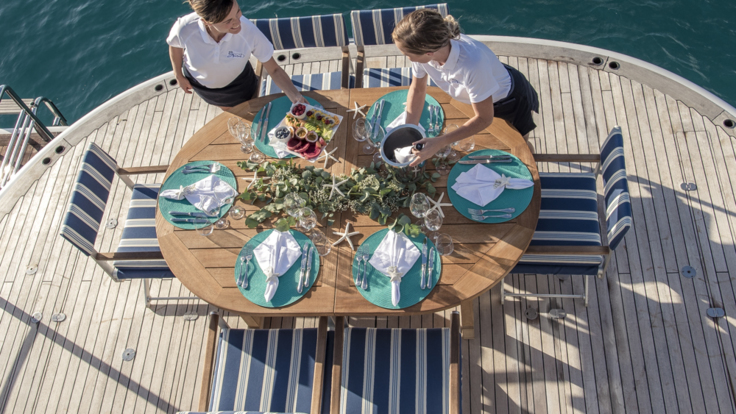 Superyacht Great Barrier Reef - Aft deck outdoor dining overlooking the beautiful Great Barrier Reef in Australia