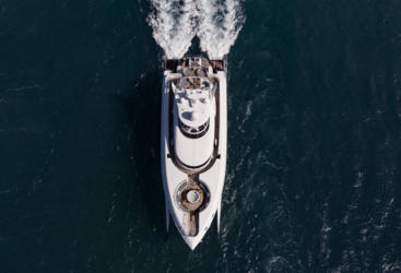 Aerial view of Superyacht underway on the Great Barrier Reef in Australia