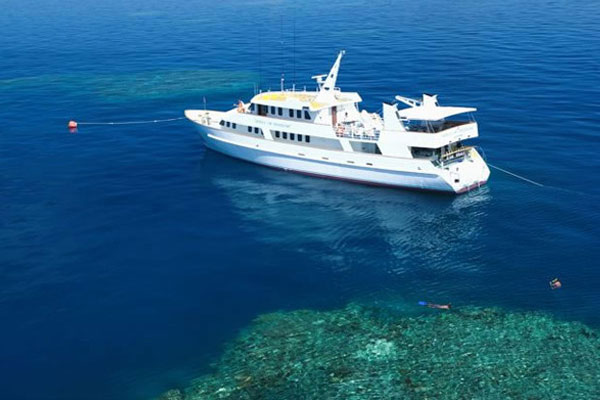 Aerial view of liveaboard dive boat on the Coral Sea