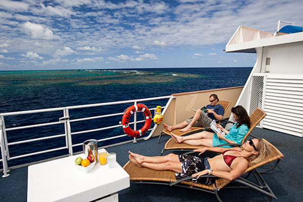 Sun deck relaxation area on liveaboard dive boat