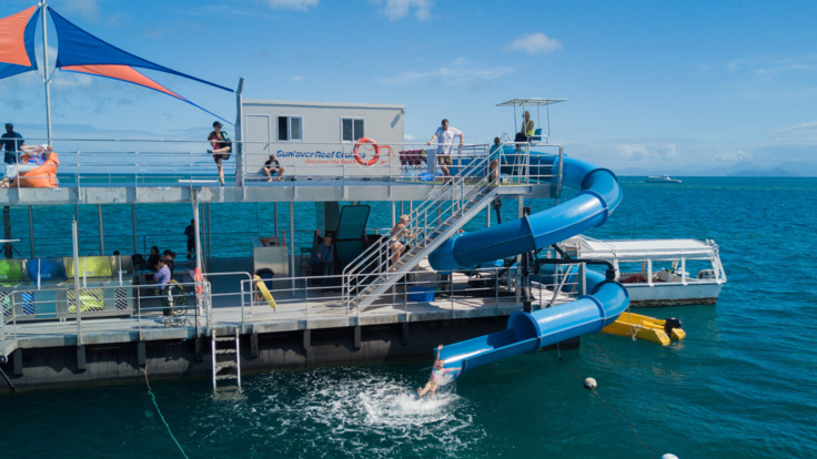 Moore Reef pontoon and spaghetti waterslide, Great Barrier Reef tour from Cairns