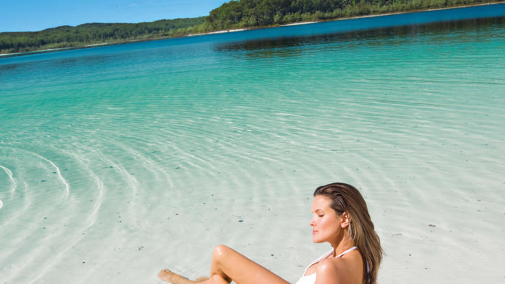 Relax in the crystal clear waters of Lake Birrabeen - Fraser Island