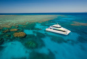 Aerial view your Cairns dive boat on the Great Barrier Reef