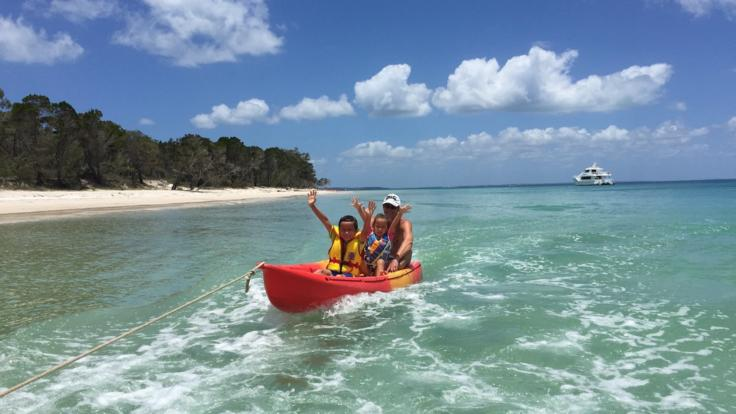 Have a ride on the inflatables on your half day cruise to remote beach from Hervey Bay