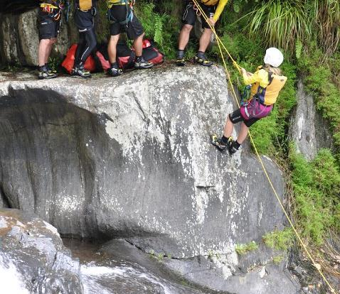Abseiling down a canyon in Cairns