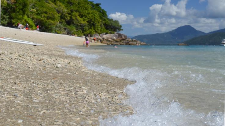 Waves Lapping Against Coral Beach Fitzroy Island