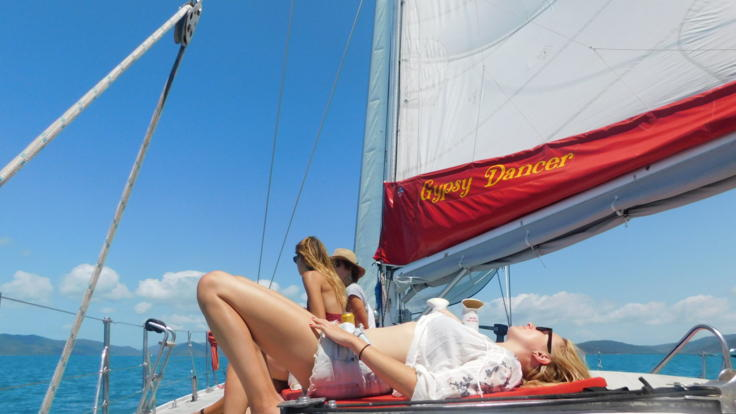 Relax on deck on or Whitsundays Sailing Boat