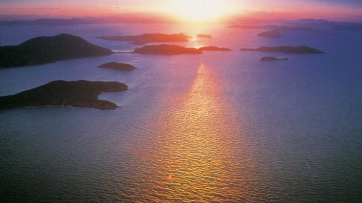 Amazing aerial view of the sun setting on the Whitsunday Islands Great Barrier Reef