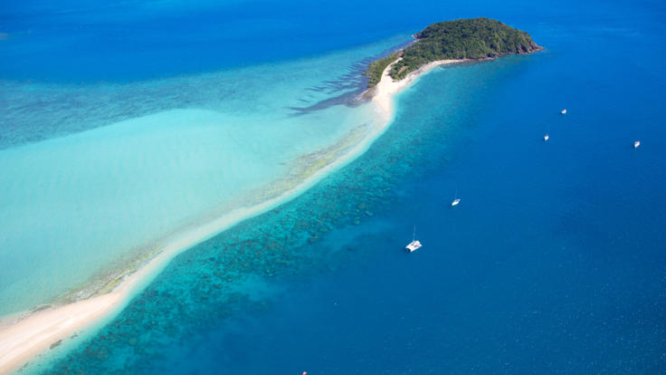 Aerial view Langford Reef and island in the Whitsunday Islands