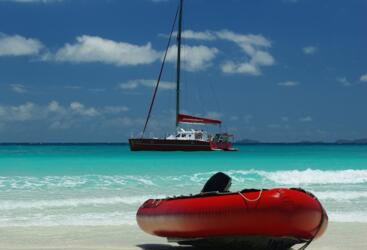 Take a tender ride to Whitehaven Beach from the yacht