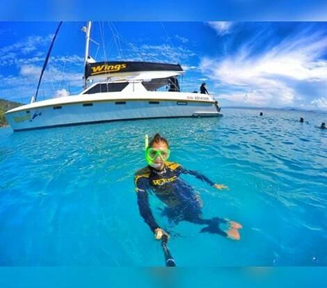 Snorkeller in the water in the Whitsunday Islands on liveaboard yacht