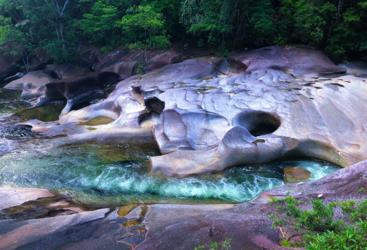 The carvings in the boulders from flowing water on Wooroonooran Safaris Tour