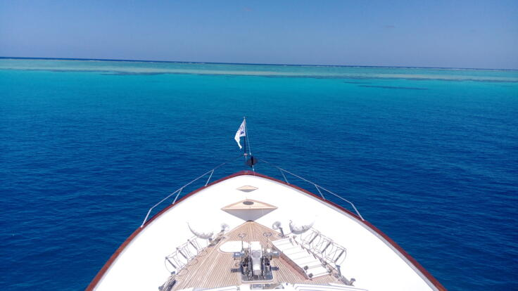 YOTSPACE superyacht voyages - Phoenix One anchored Great Barrier Reef