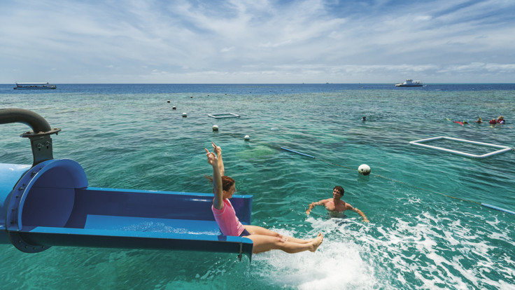 Sliding down the pontoon spaghetti waterslide at Moore Reef on the Great Barrier Reef