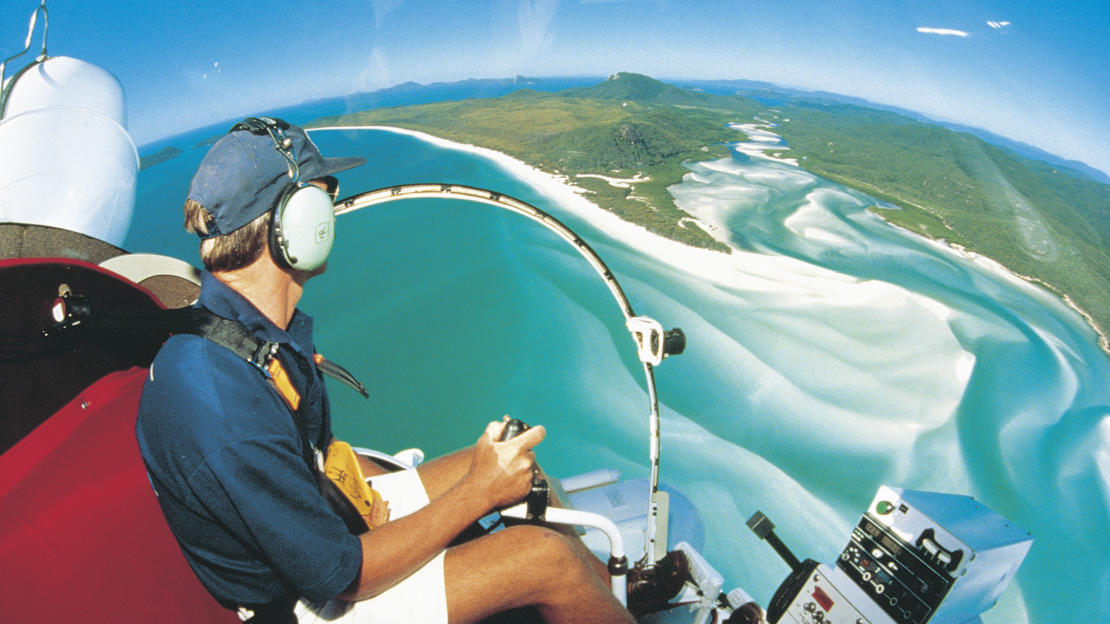 Barrier Reef Australia: View from the seat of helicopter over Whitehaven Beach in Whitsundays
