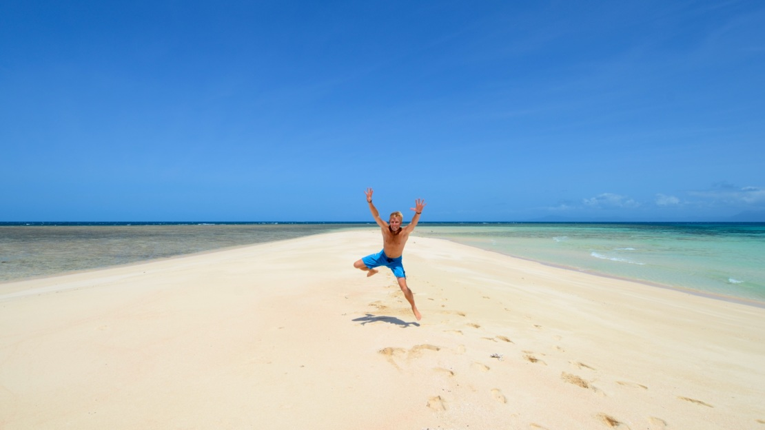 Fun on the sand cay, Tropical North Queensland, Australia