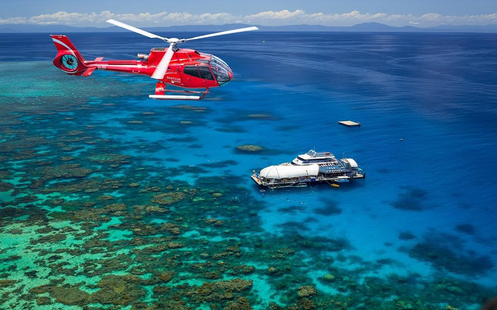 Barrier Reef Australia: Helicopter flying over ponton on the Great Barrier Reef off Cairns