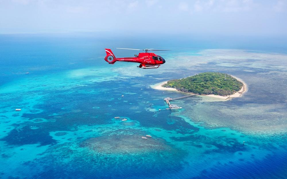 Barrier Reef Australia: View of helicopter flying over Green Island just off Cairns