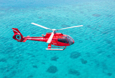 Barrier Reef Australia: Helicopter flying over the Great Barrier Reef in Australia